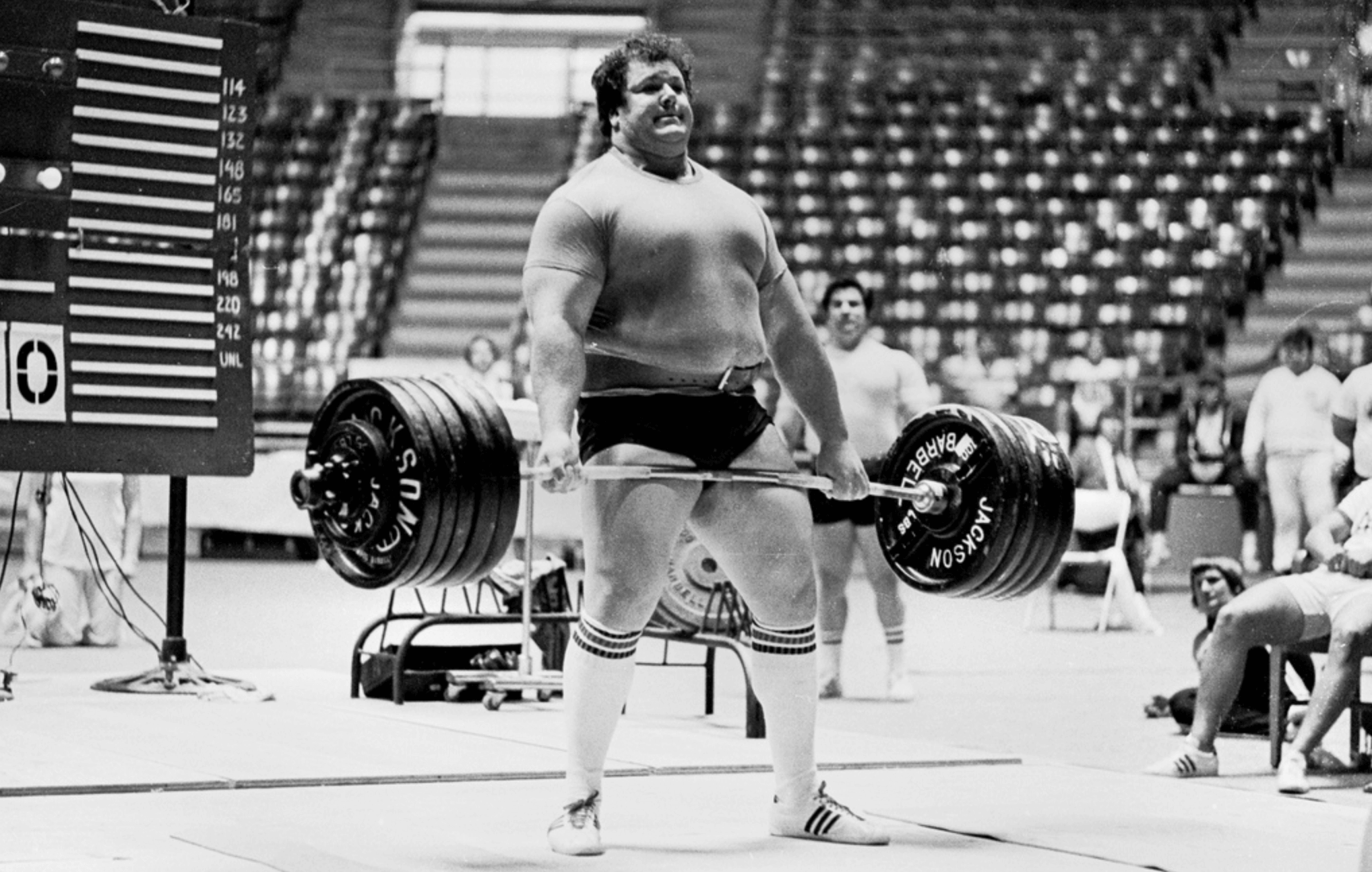 "Don Reinhoudt – one of the all-time great lifters.  He thought he totaled 2420 in the 1970s, but when they weighed the plates after the meet, they discovered that they were underweight, and that his total was ""only"" 2391."