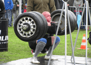 Strongman front squats large tires